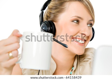 Portrait of beautiful smiling call center woman holding cup, looking left - stock photo