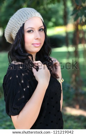 portrait of beautiful smiling girl in fashionable winter cap