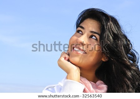 Portrait of beautiful smiling girl looking up