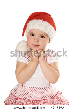Portrait of beautiful smiling little girl in hat of santa claus isolated on white background - stock photo
