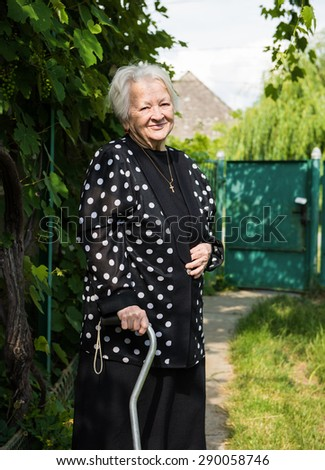 Portrait of beautiful smiling old woman outdoors