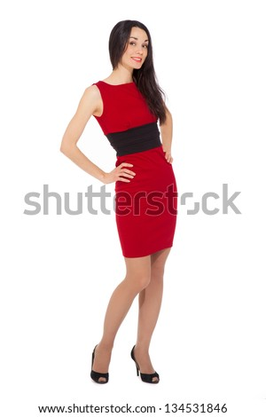 portrait of beautiful smiling woman wearing red dress and black shoes over white background - stock photo