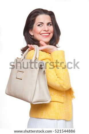 Portrait of beautiful smiling woman with  handbag.