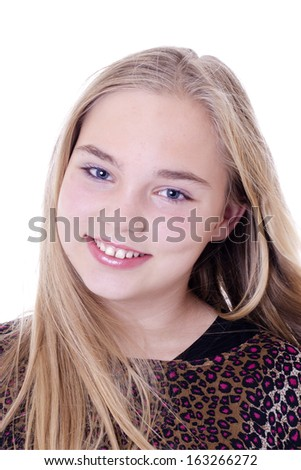 Portrait of beautiful smiling 12 years blond girl - stock photo
