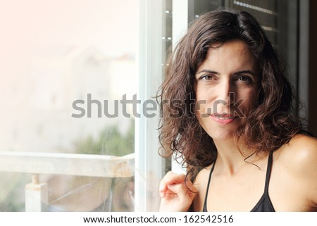 Portrait of beautiful smiling 35 years old woman - stock photo