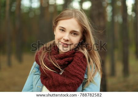 Portrait of beautiful smiling young woman outdoors