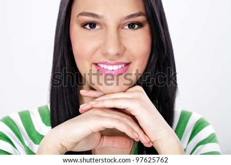 Portrait of beautiful smiling young woman with equal teeth,  close up - stock photo
