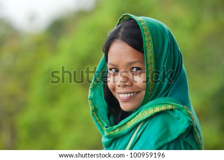 Portrait of beautiful south-east asian looking young woman - stock photo