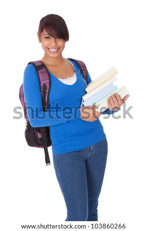 Portrait of beautiful student girl with books. Isolated on white - stock photo