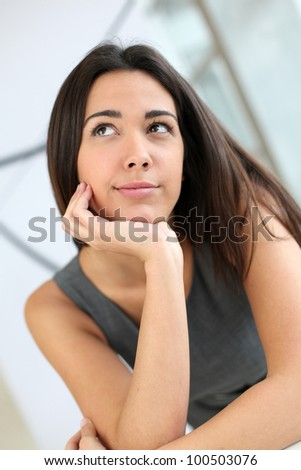 Portrait of beautiful student with hand on chin - stock photo