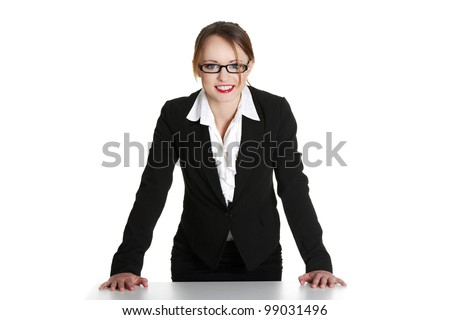 Portrait of beautiful successful businesswoman standing behind the desk. Isolated on white - stock photo