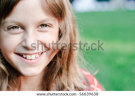 Portrait of beautiful teen girl outdoors in summertime - stock photo