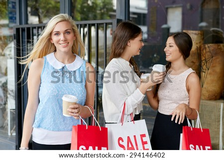 portrait of beautiful teen girl shopping in city with friends standing outdoors - stock photo
