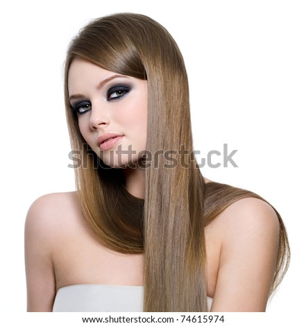 Portrait of beautiful teen girl with long straight hair and black eye make-up - white background - stock photo