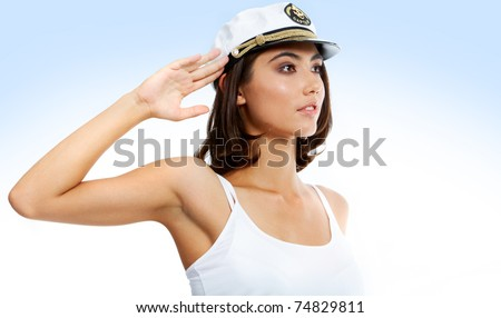 Portrait of beautiful teenager with peak-cap on her head keeping hand by temple - stock photo