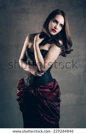 Portrait of beautiful vampire woman - stock photo