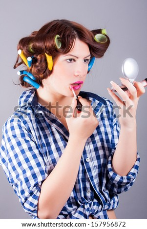 portrait of beautiful woman applying mascara brush - stock photo