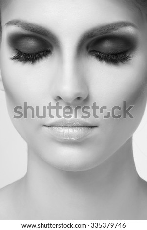 Portrait of beautiful woman. Beautiful woman with evening make-up. Black and White. Fashion photo