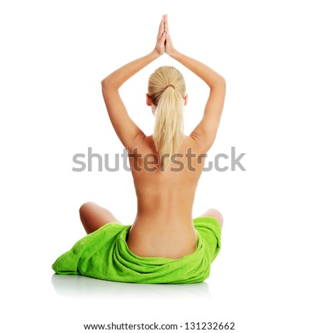 Portrait of beautiful woman before spa treatment. Isolated - stock photo