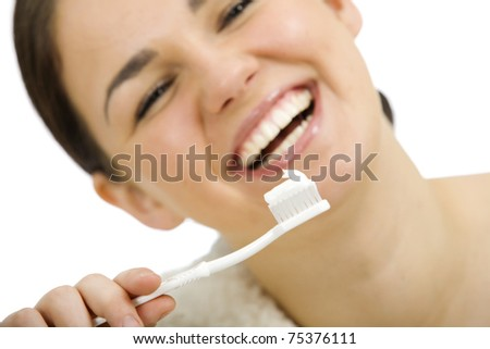 Portrait of beautiful woman brushing her teeth - stock photo