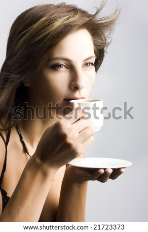 Portrait of beautiful woman drinking coffee - stock photo