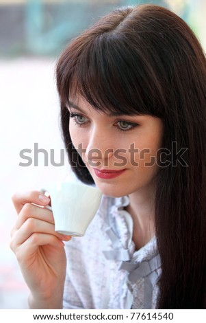 Portrait of beautiful woman drinking coffee - stock photo