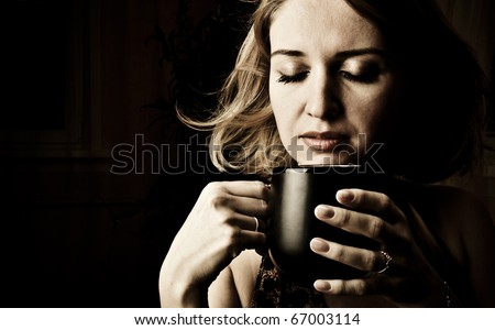 Portrait Of Beautiful Woman Drinking Coffee and magical wind blowing her hair - stock photo