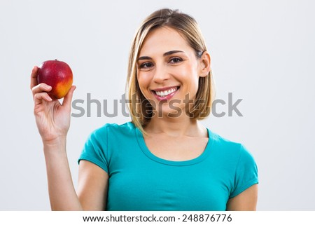 Portrait of beautiful woman holding apple in her hand.Healthy snack - stock photo