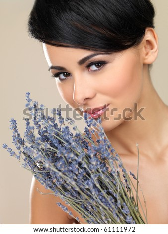 Portrait of beautiful woman, holding bunch of lavender - stock photo