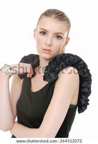 Portrait of beautiful woman in black dress on white background