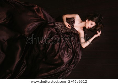 Portrait of  beautiful woman in brown dress - stock photo