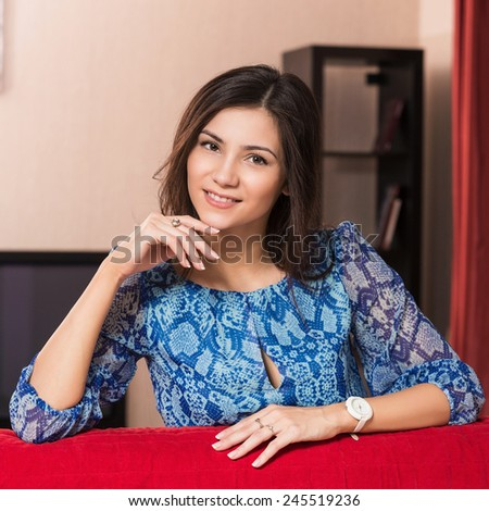 Portrait of beautiful woman in living room - stock photo