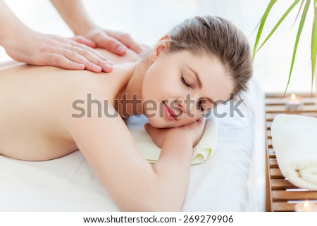 Portrait of beautiful woman in massaging room - stock photo
