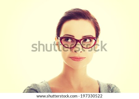 Portrait of beautiful woman in red eyeglasses - stock photo