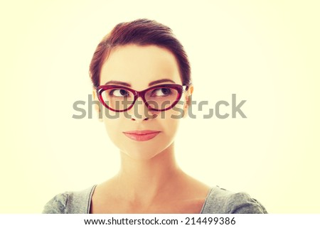 Portrait of beautiful woman in red eyeglasses. Isolated on white. - stock photo