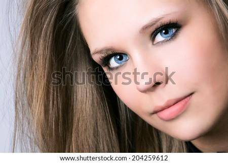 Portrait of beautiful woman in studio - stock photo
