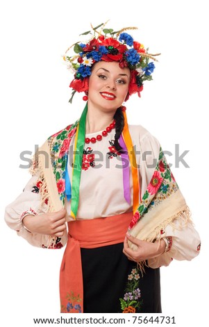Portrait of beautiful woman in the Ukrainian national clothes - stock photo