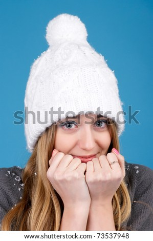 Portrait of beautiful woman in winter hat - stock photo