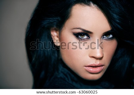 Portrait of beautiful woman isolated on brown with copyspace - stock photo