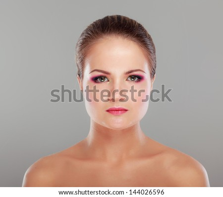 Portrait of beautiful woman isolated on grey background - stock photo