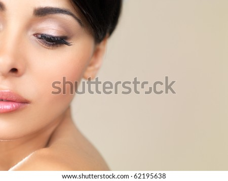 Portrait of beautiful woman looking on her left - stock photo