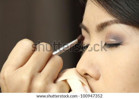 Portrait of beautiful woman, making up on her wedding ceremony. Shallow DOF