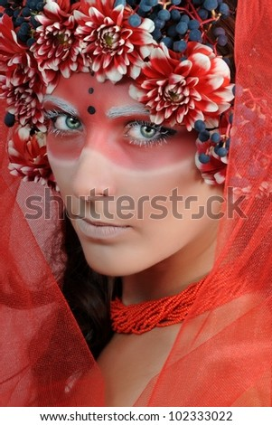 portrait of beautiful woman model face with creative red  make-up