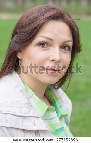 Portrait of beautiful woman on a walk in the Park