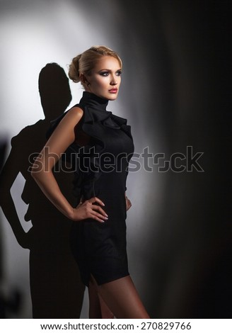 Portrait of beautiful woman on black background - stock photo