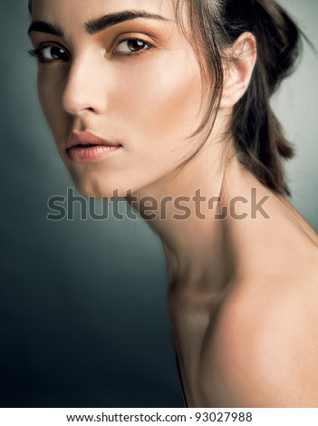 Portrait of beautiful woman on grey background - stock photo