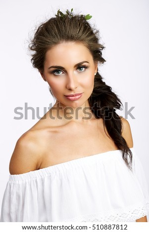 Portrait of beautiful woman on white background