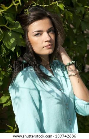Portrait of beautiful woman outdoors. - stock photo