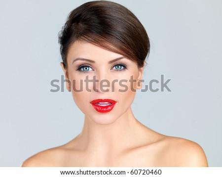 Portrait of beautiful woman, she has red lipstick - stock photo