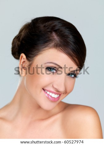 Portrait of beautiful woman, she is smiling - stock photo